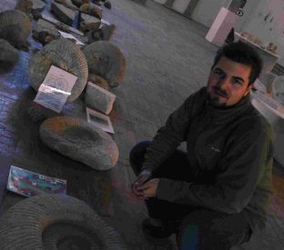 Artist James Murison looks at fossils through time exhibit at the Seas of Stone exhibition at the Drill Hall, Portland