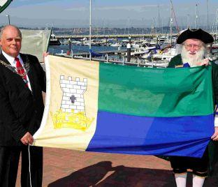 Mayor David Thurston and Town Crier Stuart Cave with the Portland flag