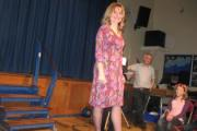 Teacher Nicky Burg models a summer dress on the runwway at St Mary's Middle School
