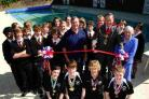 Mayor Les Phillips with headteacher Andrew Roberts-Wray, school pupils and the South Dorset Tornadoes swimming team
