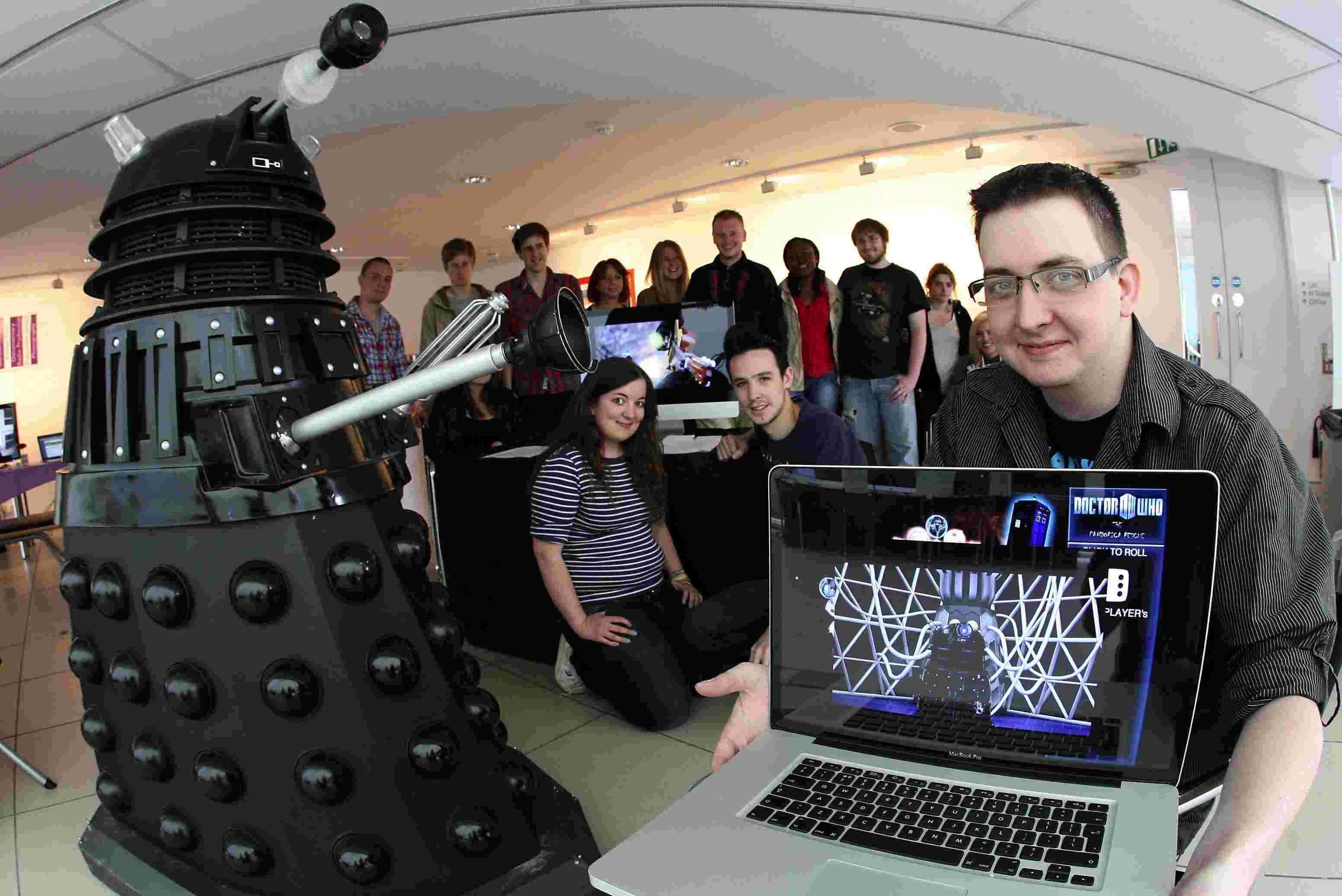 Digital media student Doug Inman with his lifesize Dalek that features in a video game he produced