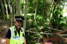 Malcolm Watson with PC Stan Knight in the Woodland Trust wood