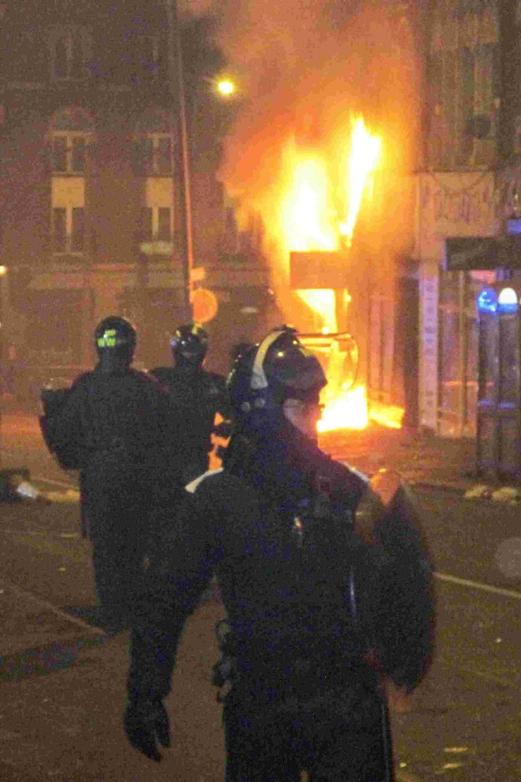 Riot officers dealing with the violence