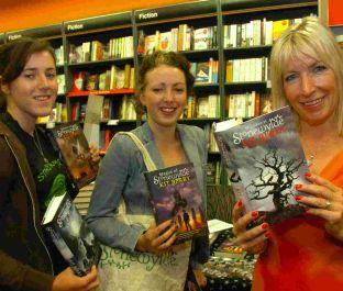 Dorset Echo: Dervla and Kelley Ireland with author Kit Berry at Waterstones