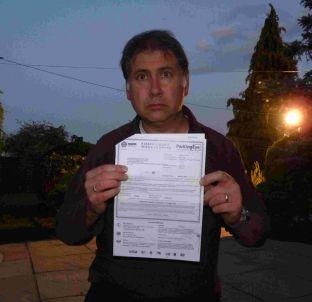 David Brimson with his parking charge notice from Old Town car park in Weymouth