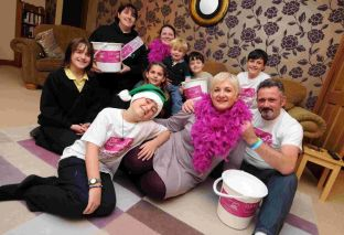Lyn Kirkland with her son Rory, husband Hamish and supporters of CLIC Sargent