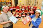 Beechcroft St Pauls Primary School pupils with christmas toy boxes. They are pictured with teacher Craig Holloway, left, and teaching assistant Deanne Obeirne, right