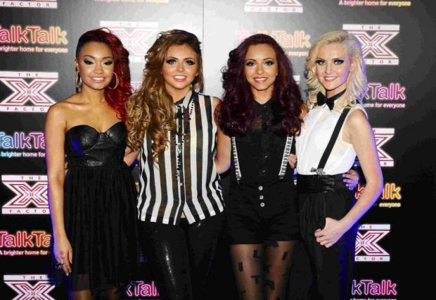 Leigh-Anne Pinnock, Jesy Nelson, Jade Thirlwall and Perrie Edwards of Little Mix who won the X Factor final on Sunday nig