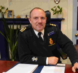 Portland Coastguard district officer Mark Rodaway receives an OBE