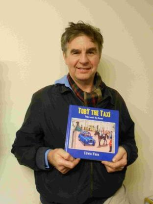 Illustrator Paul Dilworth with a copy of Toby the Taxi