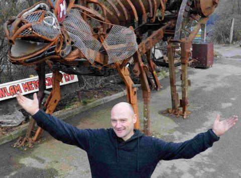 Mark House with his scrap metal stegosaurus dinosaur which he believes would have been better