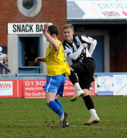 ARCHING VOLLEY: Sam Malsom scores on his Magpies' debut