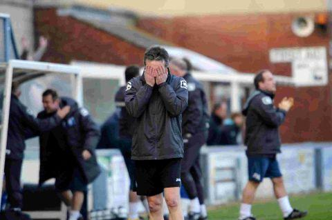 HORROR SHOW: Phil Simkin holds his head in his hands as the Magpies concede another goal