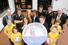 ON THEIR MARKS: Royal Manor Arts College students, headteacher and deputy headteacher with the Bring on The Games sticker