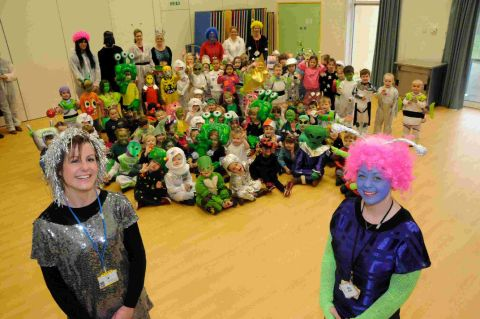 SPACED OUT: Teachers Amy O'Connor and Laura Stainer with the reception class children and other staff who are dressed as aliens