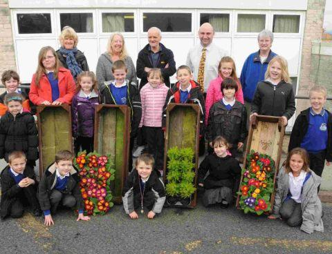 GROWTH: Pupils and teachers from Underhill Junior School and Brackenbury Infants School with Gary Hockett who gave the schools the planters