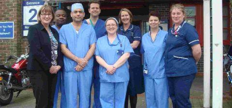 Consultant surgeon Mr Naveed Afzal, third from left, with Dorset County Hospital chief executive Jean O'Callaghan, far left, and the template biopsy team at DCH Day Surgery Unit