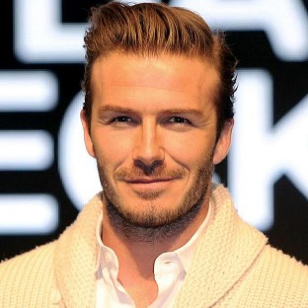 Dorset Echo: David Beckham will be gracing the cover of Elle magazine