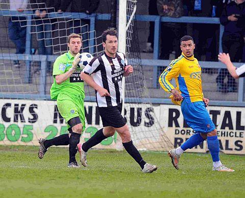 Dorset Echo: DONNING THE GLOVES: Kyle Critchell is protected by skipper Mark Jermyn