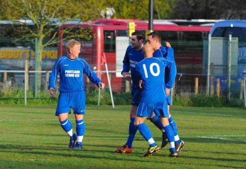 MATCHWINNER: Tom Carter is congratulated after scoring the all-important winner against Chickerell United