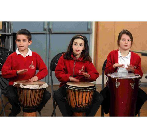 Pupils at Frome Valley School learn about drums at the school's music week