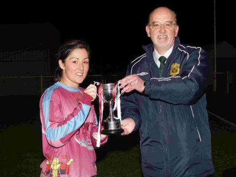 ROSIE'S REWARD: Rosie Sharpe receives the Women's Cup from Ian Kellett, chairman of the DCFA Women's Committee