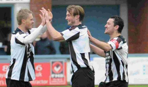 SUPER SAM: Sam Malsom, left, is congratulated by Jamie Gleeson and Mark Jermyn after scoring the equaliser on Saturday