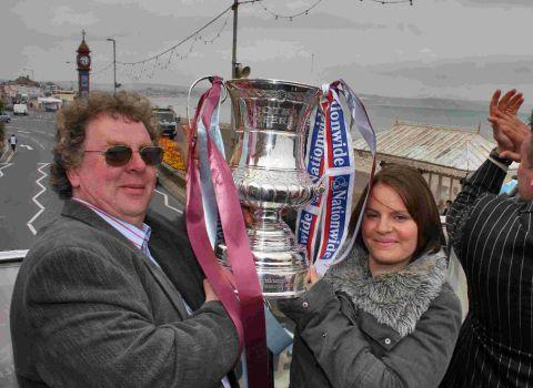 MISSED: Former Weymouth FC chairman Martyn Harrison with his daughter Fay parading the Conference South trophy on the town's esplanade