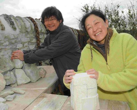 ROCK STARS: Japanese artists Takahiro Ishii and Masami Aihara at work on Portland