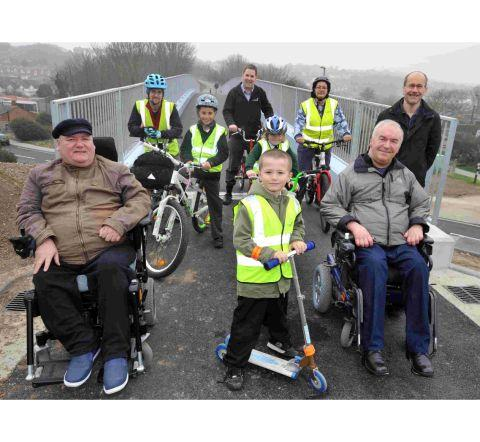 Cyclists and disabled people on the new bridge
