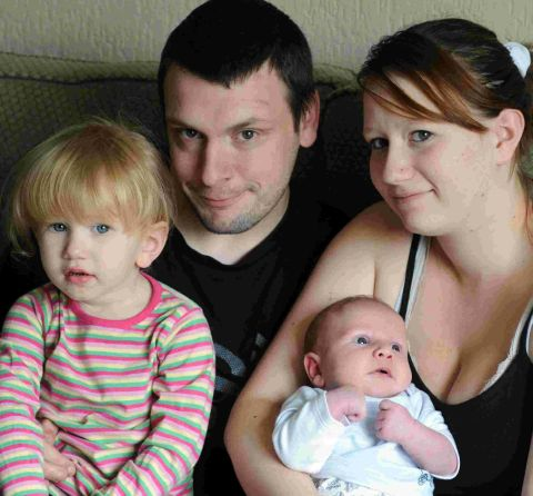 NEW ARRIVAL: Baby Connor Rutherford with sister Brooke and parents Abi and Pete