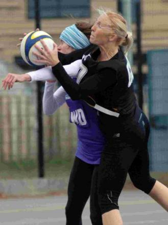 CRUNCH: Loose Moose's Donna Redfern (black) is challenged by New Image's Polly Knight