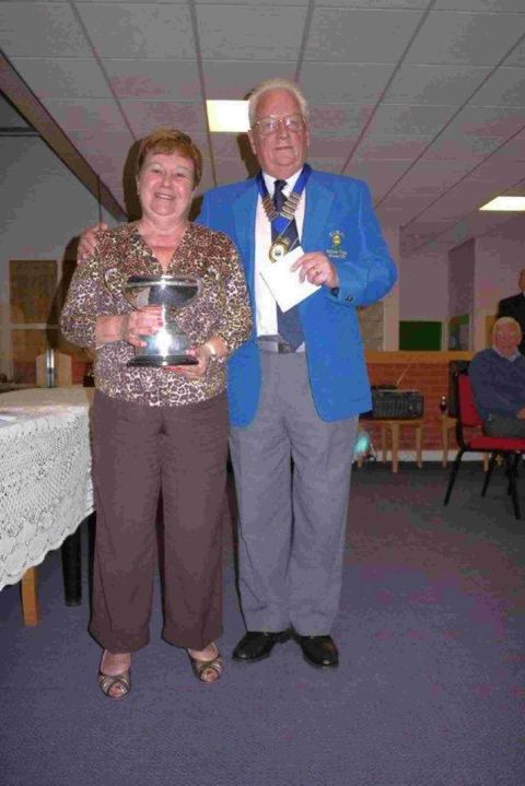 TROPHY DELIGHT: Sheila Baker with president Mike Goddard