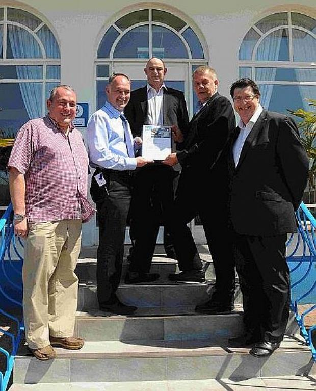 ONE-YEAR DEAL: Associate director Iain Stone, Kevin Bungay (manager Riviera Hotel), Terras' boss Brendon King, chairman Nigel Biddlecombe and Terry Schofield (managing director, MJM Sports)