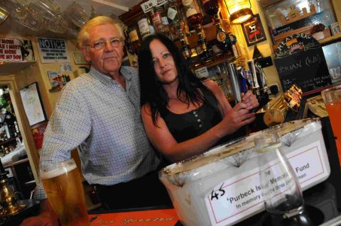 MAKE A DONATION: Chris Baker and Caroline Cashman with the Purbeck Isle collection box at Chapelhay Tavern