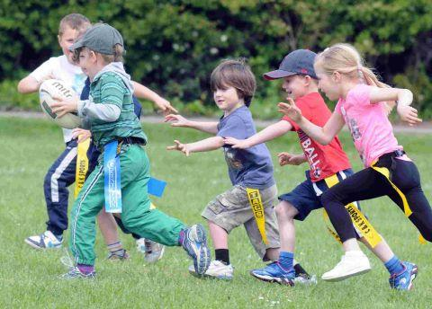 ON THE RUN: Enjoying the tag rugby at the Saturday Sports Club at Conifers School