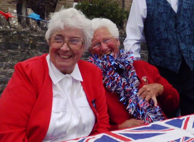 Gloria Eveleigh and Marjorie Long enjoy themselves at the Cattistock Street Party