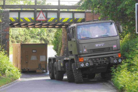 WELL-BLOCKED: The military lorry that lost its load under a railway bridge