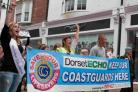 MAKING THEIR VOICES HEARD: Marchers with a Save our Lifesavers banner in Weymouth town centre. Pictured from left are Danni De Bear, Sandy West, Adam Greaves and Fi Woods