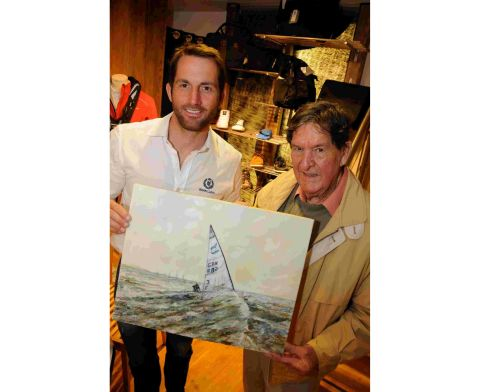 Ben Ainslie is presented a painting by artist John Lee