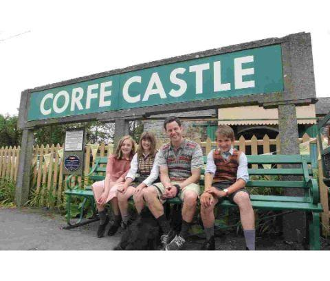 Countryfile presenter Matt Baker on an Enid Blyton adventure at Corfe Castle with local children Ben White, Molly Britten and Emily Ford