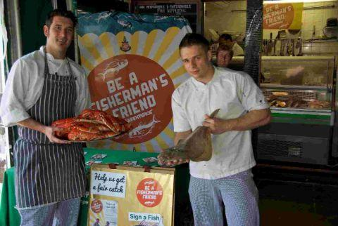 Chefs from Hive Beach Café, Burton Bradstock, displaying lobster and fish off the morning boats
