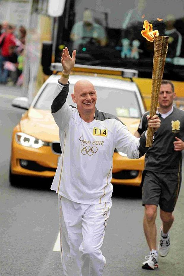 GUEST SPEAKER: Duncan Goodhew carrying the Olympic torch through Cornwall