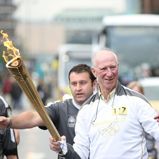 Grylls zips in with Olympic torch