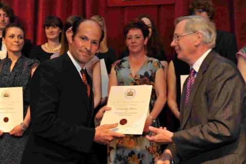 Cameron Short receives the Queen Elizabeth Scholarship Trust certificate from the Duke of Gloucester