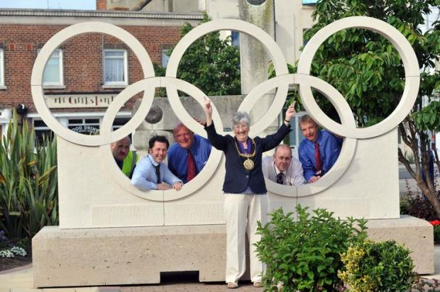 Portland stone Olympic rings were craned into the forecourt of Weymouth Railway Station. Mayor Margaret Leicester was there to see their early morning arrival.   DORSET MEDIA SERVICE