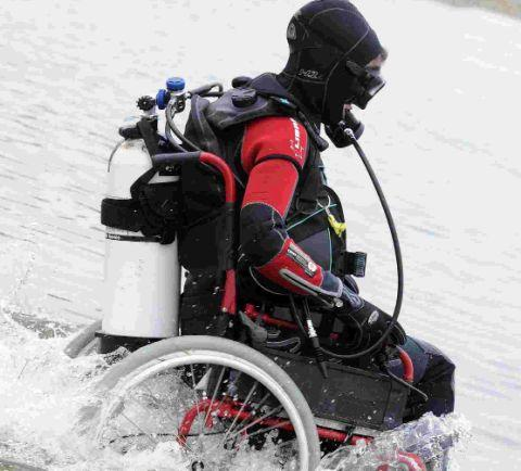 TAKING THE PLUNGE: Sue Austin crosses the Fleet by wheelchair
