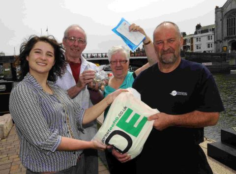THANKS A LOT: Catherine Bolado from the Dorset Echo presents money donated by Echo readers for the Purbeck Isle Memorial Fund to Colin and Grace McFarlane and Andy Alcock