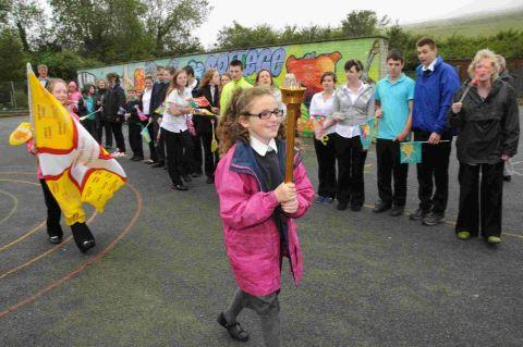 PASS IT ON: Tiffany Park parades the torch around the playground at Westfield Arts College