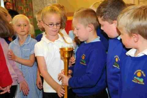 LOOK AT  THIS: The torch is examined at Bincombe Valley Primary School